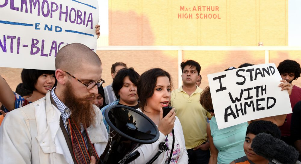 We hear the story of a 14-year-old Muslim boy arrested for bringing his homemade clock to his Texas high school, and we want to think, 'That's just Texas.' If only that were true. Pictured: Protesters at a prayer vigil in support of Ahmed Mohamed, Thursday, Sept. 17, 2015, in Irving, Texas. (Jeffrey McWhorter/AP)