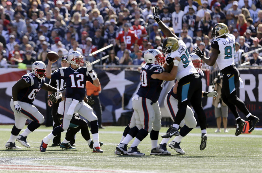 New England Patriots quarterback Tom Brady (12) passes against the rush by Jacksonville Jaguars defensive tackle Abry Jones (95) and Jaguars defensive end Ziggy Hood (92) in the first half of an NFL football game on Sunday in Foxborough, Mass. (Charles Krupa/AP)