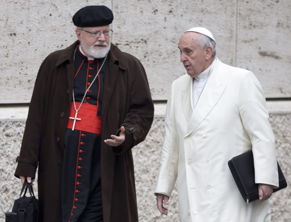 In this Feb. 13, 2015 file photo, Pope Francis, right, talks with Cardinal Sean O'Malley, of Boston, as they arrive for a special consistory in the Synod Hall at the Vatican. (Andrew Medichini/AP/File)