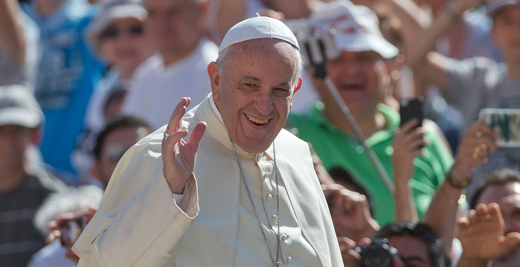 Pope Francis waves as arrives for his weekly general audience in St. Peter's Square at the Vatican in August. (Alessandra Tarantino/AP)