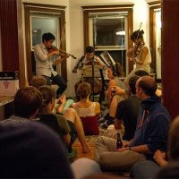 Groupmuse is an organization that brings classical music into homes. Here is a recent Groupmuse party in Somerville. (Hadley Green for WBUR)