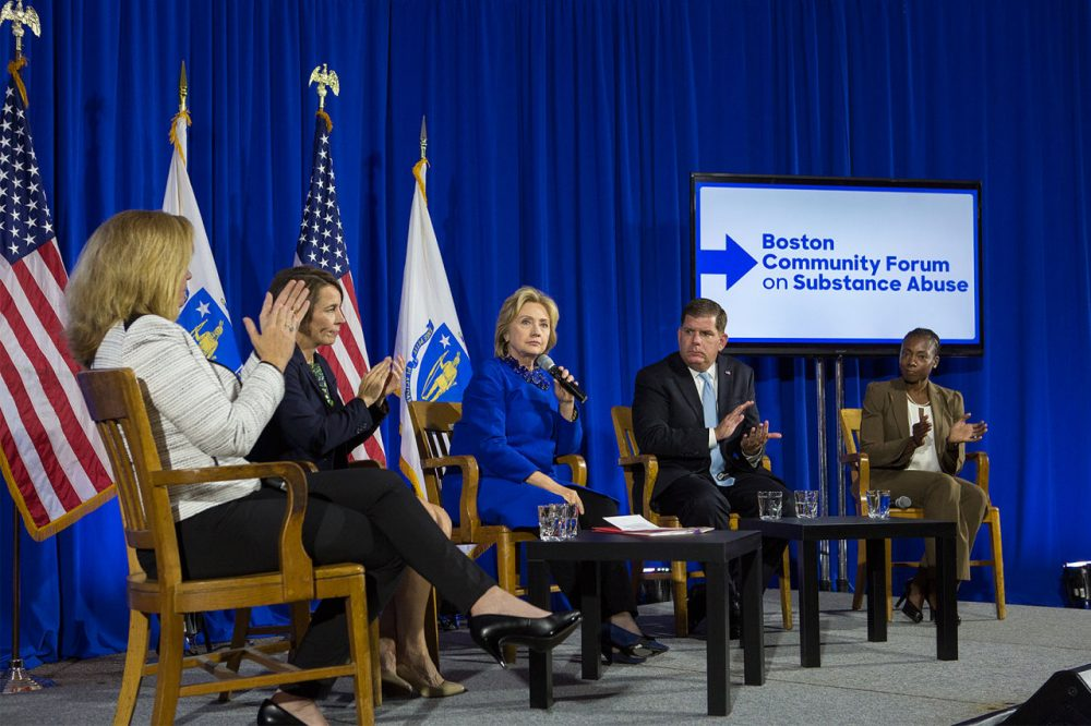 Democratic presidential candidate Hillary Clinton, center, is joined by state Attorney General Maura Healey and Boston Mayor Marty Walsh at the Boston Community Forum on Substance Abuse Thursday. (Jesse Costa/WBUR)