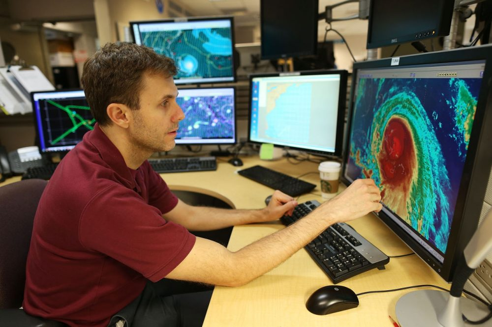 Hurricane specialist Eric Blake uses a computer at the National Hurricane Center to track the path of Hurricane Joaquin, a Category 3 storm with maximum sustained winds of 125 mph, as it passes over parts of the Bahamas on October 1, 2015 in Miami, Florida. The National Hurricane Center forecasters are still trying to determine if the hurricane will turn to the north and northwest, which might affect the U.S. East Coast. (Joe Raedle/Getty Images)