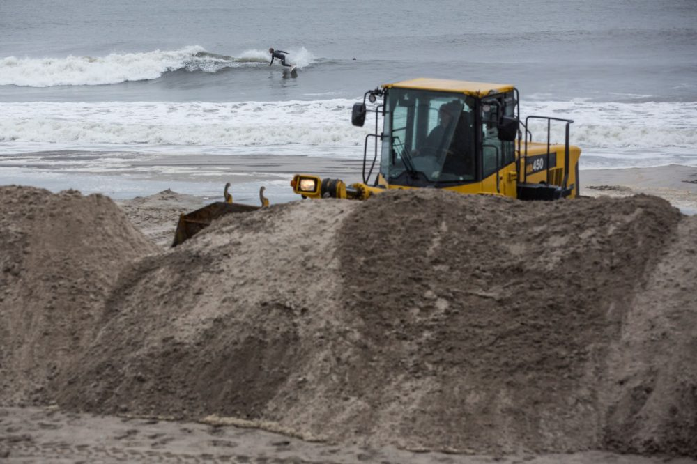 A bull dozer builds sand berms on the beach in preparation for Hurricane Joaquin in Long Beach, New York. The category 4 storm is currently near the Bahamas and has the potential to make landfall in the Long Island region early next week.  (Andrew Burton/Getty Images)