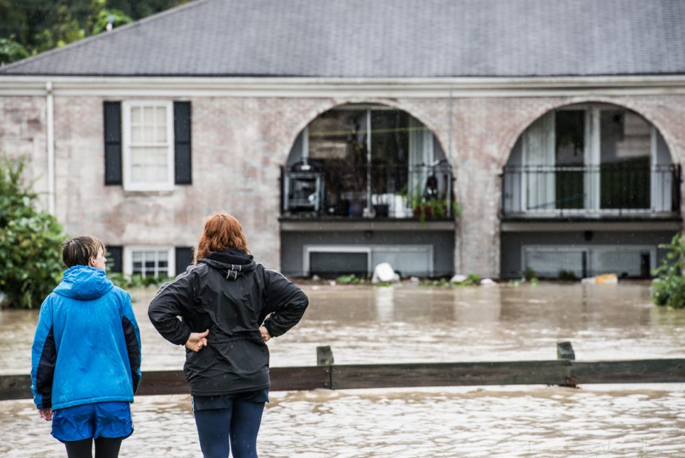 People look out over damage caused by flood water October 4, 2015 in Columbia, South Carolina. (Sean Rayford/Getty Images)