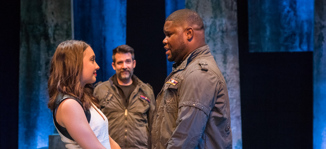 """Josephine Elwood as Desdemona, Johnnie McQuarley as Othello, and John Kuntz as Iago, lurking in the background in the Actors' Shakespeare Project's production of """"Othello."""" (Stratton McCrady Photography)"""
