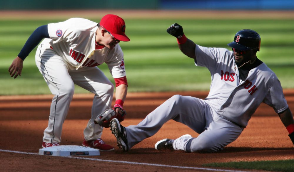 David Ortiz, right, is tagged out by Cleveland Indians' Giovanny Urshela while attempting to steal third base during the first inning of a baseball game, Sunday, Oct. 4, 2015, in Cleveland. The Red Sox lost the game 3-1. (Ron Schwane/AP)