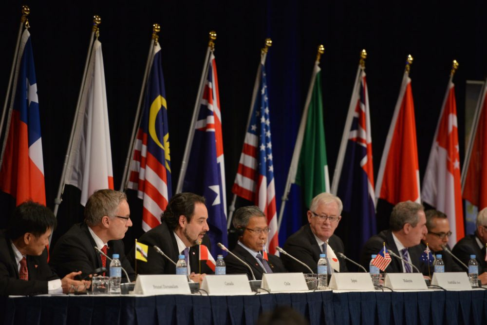 Trade representatives attend a press conference for the Trans-Pacific Partnership (TPP), a pan-Pacific trade agreement by trade ministers from 12 nations in Sydney on October 27, 2014. The TPP, which would encompass 40 percent of the global economy and include 12 nations, just struck a deal today. (Peter Parks/AFP/Getty Images)