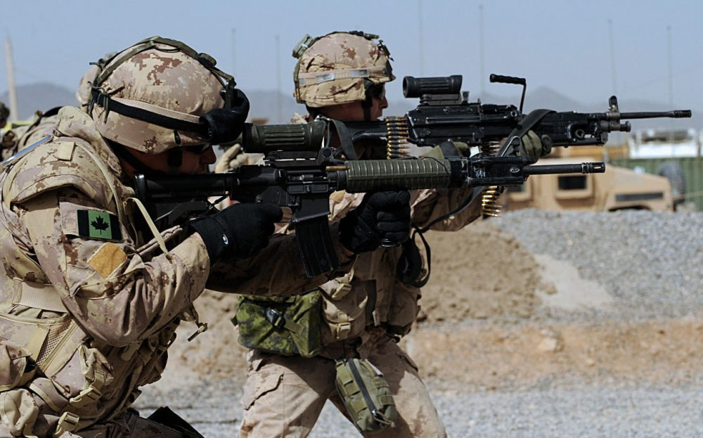 Canadian soldiers with the NATO-led International Security Assistance Force (ISAF) fire their weapons during an exercise at the base of Provincial Reconstruction Team (PRT) in Kandahar Province on March 26, 2008. (Shah Marai/AFP/Getty Images)