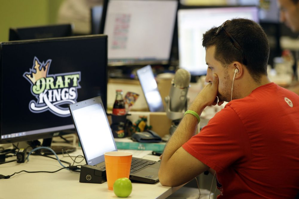 Devlin D'Zmura, a DraftKings employee, works on his laptop at the company's offices in Boston. (Stephan Savoia/AP)