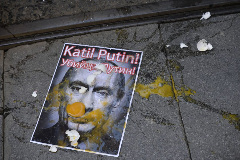 A picture depicting Russian President Vladimir Putin is splattered with eggs during a protest against Russian military operations in Syria, in Istanbul, Turkey, Saturday, Oct. 3, 2015. (AP)