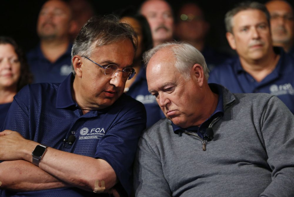 Fiat Chrysler Automobiles CEO Sergio Marchionne, left, and United Auto Workers President Dennis Williams talk during a ceremony to mark the opening of contract negotiations in Detroit, July 14, 2015. (Paul Sancya/AP)