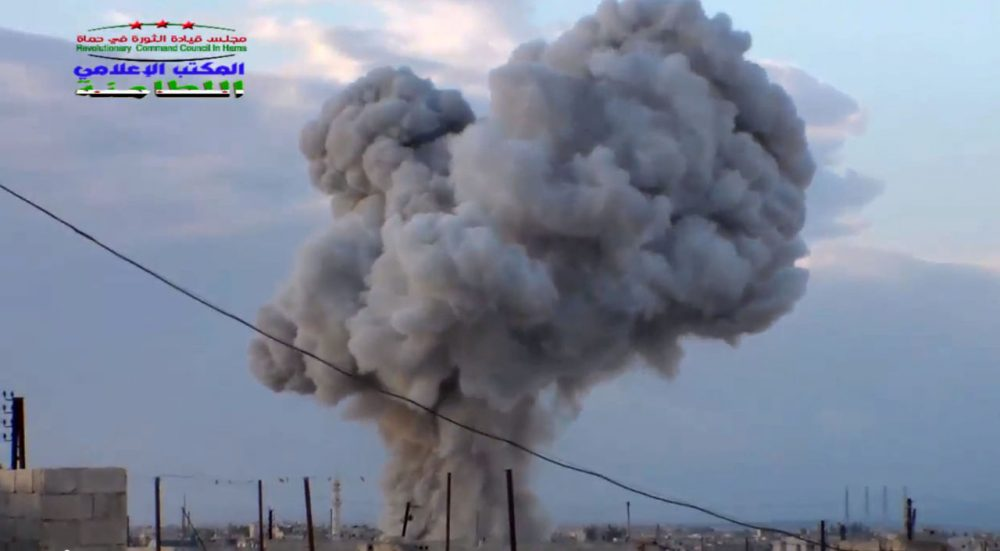 This image taken from video provided by the Syrian activist-based media group Syrian Revolutionary Command Council in Hama, which has been verified and is consistent with other AP reporting, shows smoke rising after a Russian airstrike hit buildings in the town of Latamna in the area of Hama in Eastern Syria, Wednesday, Oct. 7, 2015. (Syrian Revolutionary Command Council in Hama via AP Video)