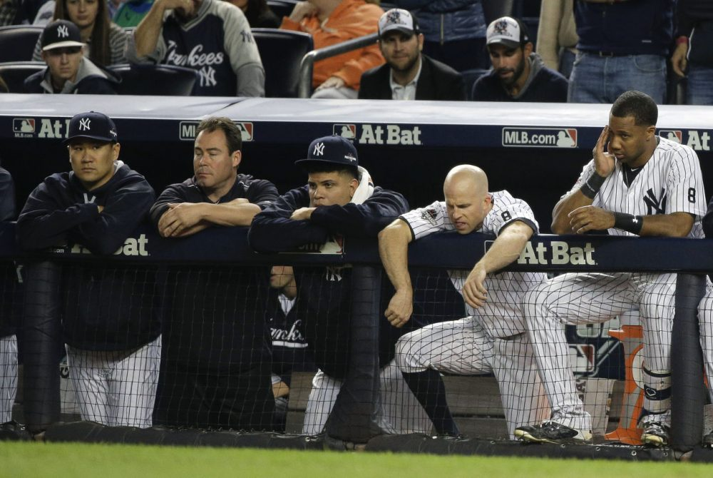 New York Yankees pitcher Masahiro Tanaka, Dellin Betances, Brett Gardner and Chris Young watch the ninth inning of the American League wild card baseball game, Tuesday. (Julie Jacobson/AP)