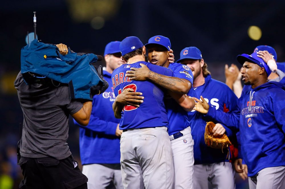 Jake Arrieta #49 of the Chicago Cubs celebrates with teammates after defeating the Pittsburgh Pirates to win the National League Wild Card game at PNC Park on October 7, 2015 in Pittsburgh, Pennsylvania. The Chicago Cubs defeated the Pittsburgh Pirates with a score of 4 to 0. (Jared Wickerham/Getty Images)