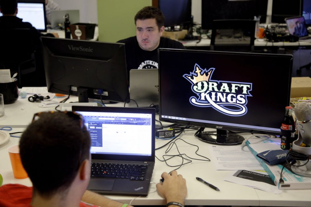 Len Don Diego, marketing manager for content at DraftKings, a daily fantasy sports company, works at his station at the company's offices in Boston. (Stephan Savoia, File/AP)