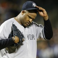New York Yankees starting pitcher CC Sabathia adjusts his cap after allowing a run and walking two batters in the first inning of a baseball game against the New York Mets in New York, Sunday, Sept. 20, 2015. (Kathy Willens/ AP)