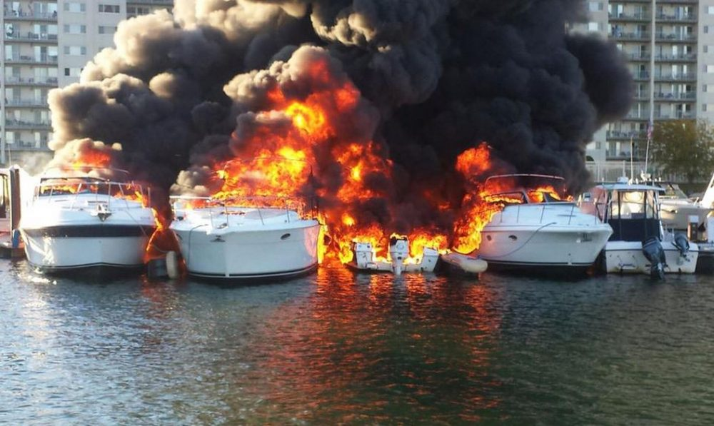 Boats on fire at the Captain's Cove Marina in Quincy, Mass. (Courtesy Quincy police via Twitter)