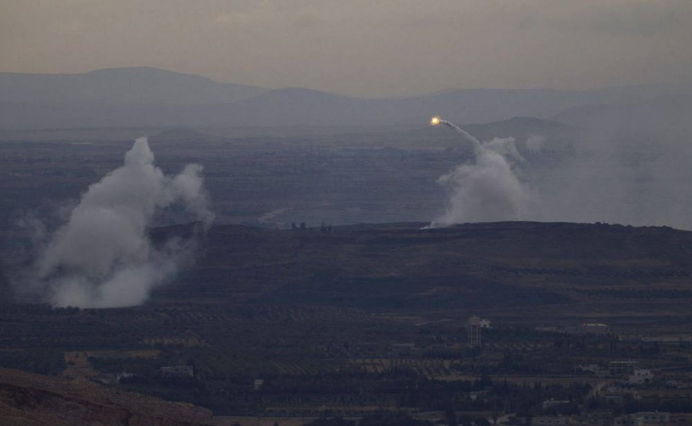A picture taken from the hill village of Buqaata in the Israeli-annexed Syrian Golan Heights shows flames and smoke ascending from alleged shelling by Syrian government forces on Islamic State group's positions near the Syrian village of Jubata al-Khashab on October 6, 2015. (Jalaa Marey/AFP/Getty Images)
