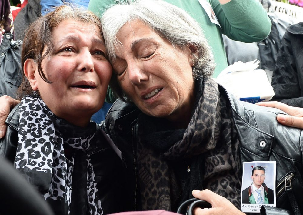 Mourners express their grief at the funeral of 32 year-old Uygar Coskun, one of the victims in the twin bomb attacks, in Ankara on October 12, 2015. After several days of silence and uncertainty, Turkey has formally pointed the finger at the Islamic State over the weekend bombing in Ankara. The development comes amid growing anger towards President Erdogan over the attack which came just three weeks ahead of elections. (STR/AFP/Getty Images)