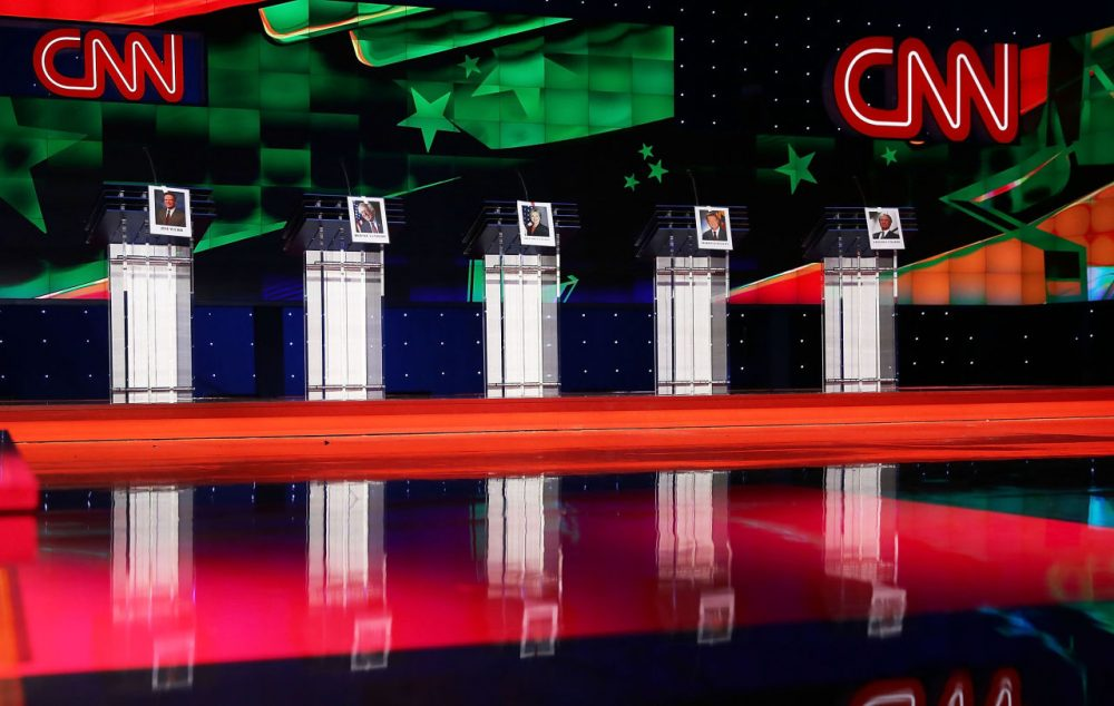 Photographs of Democratic presidential candidates, (left to right) former U.S. Sen. Jim Webb (D-VA), U.S. Sen. Bernie Sanders (I-VT), former Secretary of State Hillary Clinton, former Maryland Gov. Martin O'Malley and former Gov. of Rhode Island Lincoln Chafee hang on their debate podiums a day before the CNN Facebook Democratic Debate at the Wynn Las Vegas in Las Vegas, Nevada. (Joe Raedle/Getty Images)