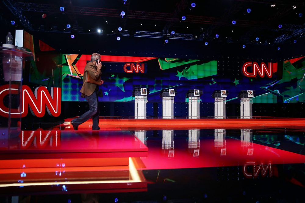 A person walks on the stage set up for the Democratic presidential candidates, former U.S. Sen. Jim Webb (D-VA), U.S. Sen. Bernie Sanders (I-VT), Hillary Clinton, Former Maryland Gov. Martin O'Malley and former governor of Rhode Island Lincoln Chafee, a day before the CNN Facebook Democratic Debate at the Wynn Las Vegas on October 12, 2015 in Las Vegas, Nevada. The debate is scheduled for tomorrow and is the first debate for the Democratic presidential contenders. (Joe Raedle/Getty Images)