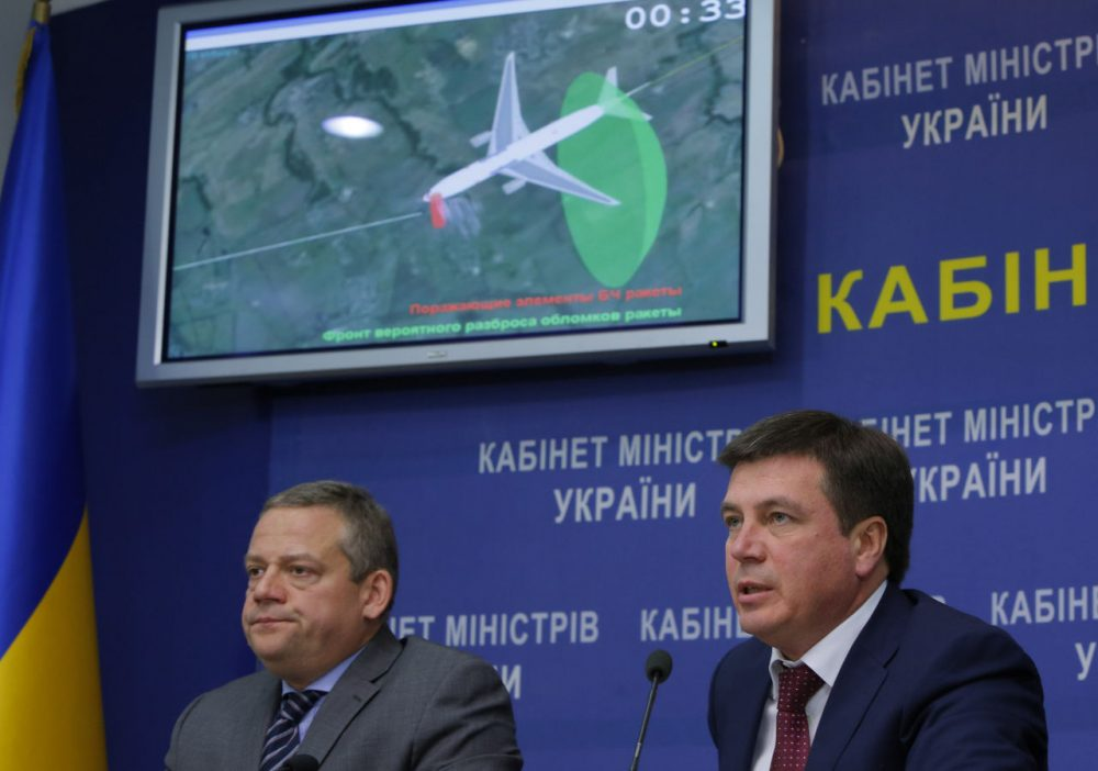 Vice Prime Minister and chairman of the government commission to investigate the causes of the MH17 crash Hennadiy Zubko, right, speaks at a briefing for journalists in Kiev, Ukraine, Tuesday, Oct. 13, 2015. Investigators said the Buk missile that downed Malaysia Airlines Flight 17 exploded less than a meter from the cockpit, killing the two pilots and the purser inside in an instant and breaking off the front of the plane. The tragedy that killed all 298 people aboard the plane on July 17, 2014, wouldn't have happened if anyone had thought to close the airspace of eastern Ukraine to passenger planes as fighting raged below, the Dutch Safety Board said.  (Sergei Chuzavkov/AP Photo)