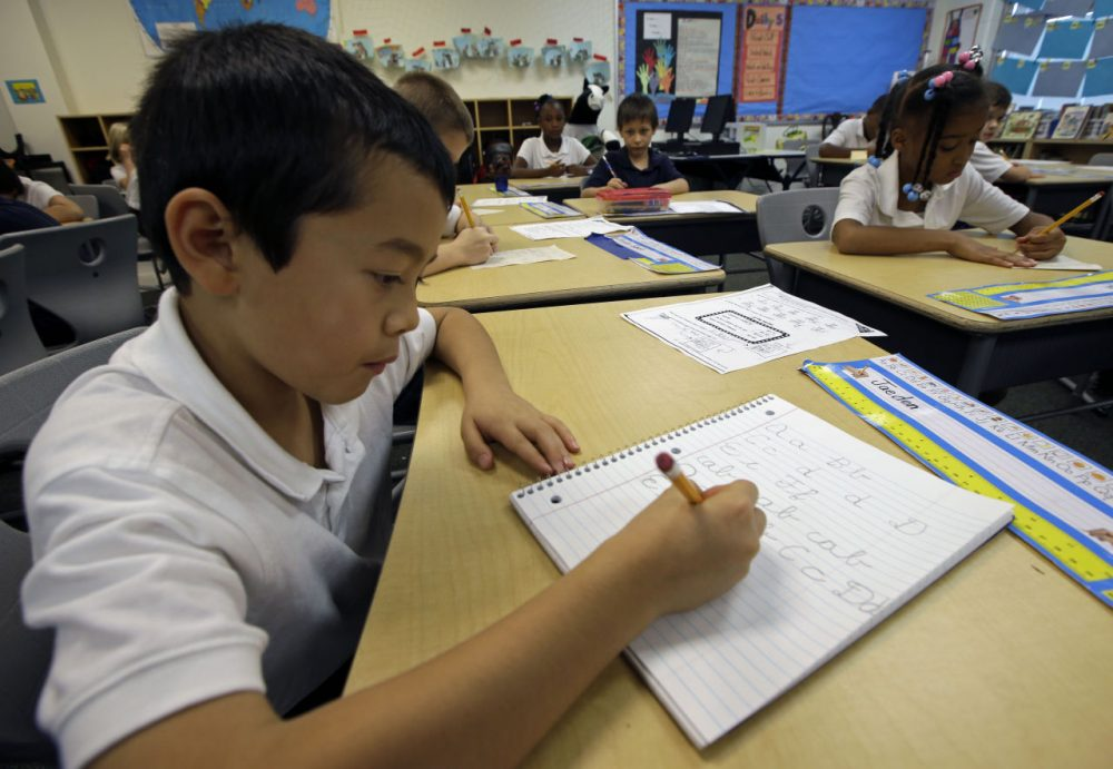 Jaeden Alvarez practices cursive writing at Cleveland K-6 School, Wednesday, Sept. 18, 2013, in Dayton, Ohio. (Al Behrman/AP)
