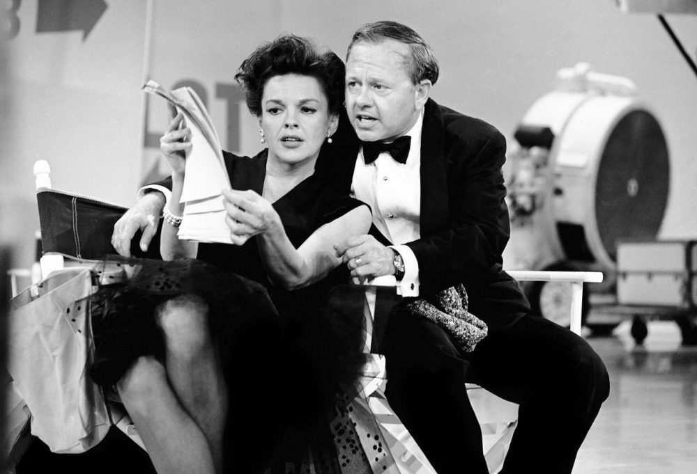 "Judy Garland and Mickey Rooney put their heads together over a television script on June 26, 1963. Garland's television variety show ""The Judy Garland Show"" ran from September 1963 to March 1964. (AP)"