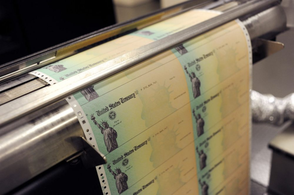 Blank social security checks run through a printer at the U.S. Treasury printing facility in Philadelphia, Pennsylvania. (William Thomas Cain/Getty Images)