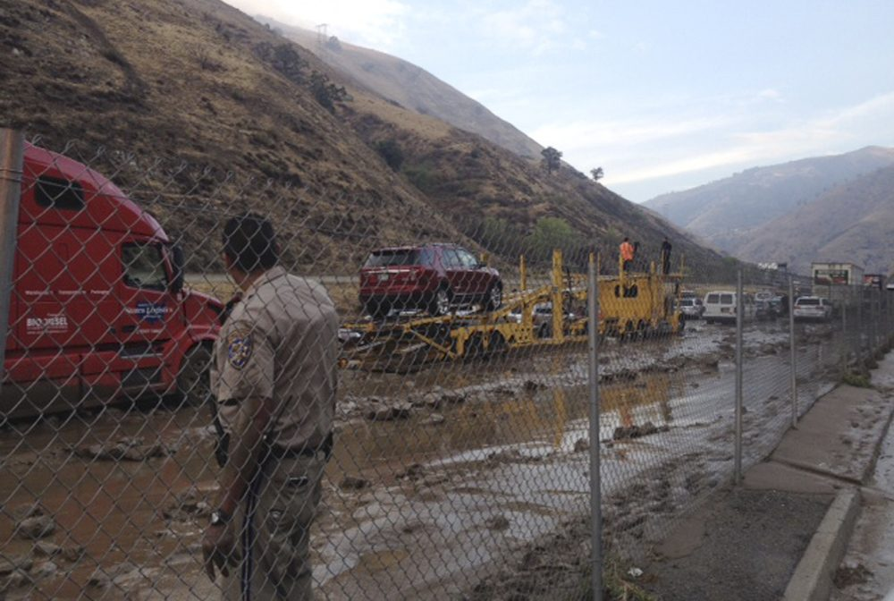 In a photo provided by Caltrans, water and mud cover Interstate 5 at Fort Tejon, about 75 miles north of downtown Los Angeles, on Thursday, Oct. 15, 2015. Flash flooding sent water, mud and rocks rushing across Interstate 5, stranding hundreds of vehicles and closing the major north-south thoroughfare. (Caltrans via AP)