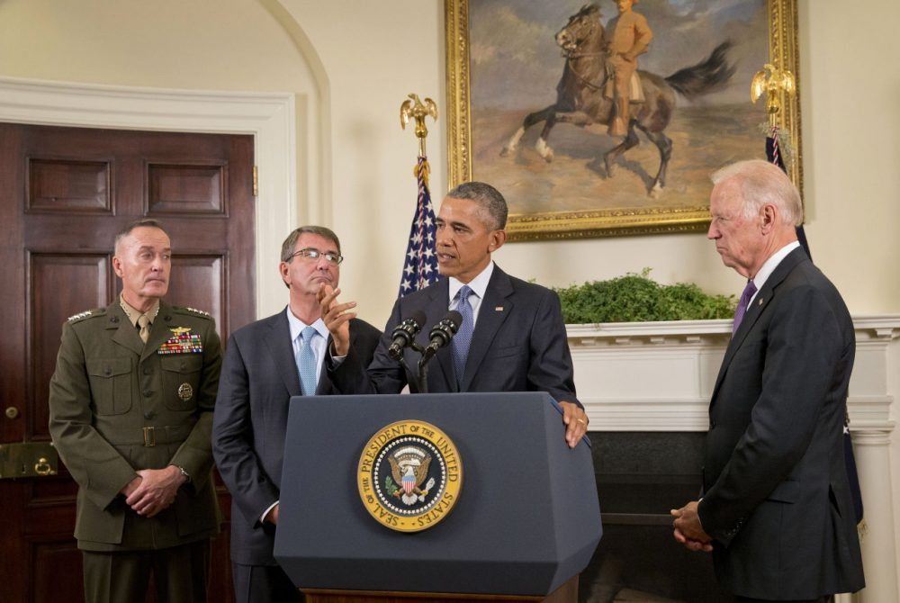 President Barack Obama, accompanied by, from left, Joint Chiefs Chairman Gen. Joseph Dunford, Defense Secretary Ash Carter and Vice President Joe Biden, answers a questions from a member of the media about Afghanistan, Thursday, Oct. 15, 2015, in the Roosevelt Room of the White House in Washington. Obama announced that he will keep U.S. troops in Afghanistan when he leaves office in 2017, casting aside his promise to end the war on his watch and instead ensuring he hands the conflict off to his successor. (Pablo Martinez Monsivais/AP)