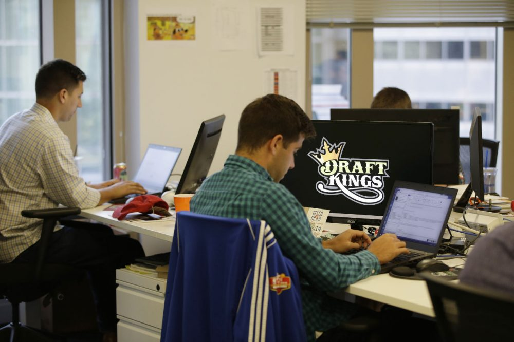 DraftKings employees work at their desks in Boston. (Stephan Savoia/AP)