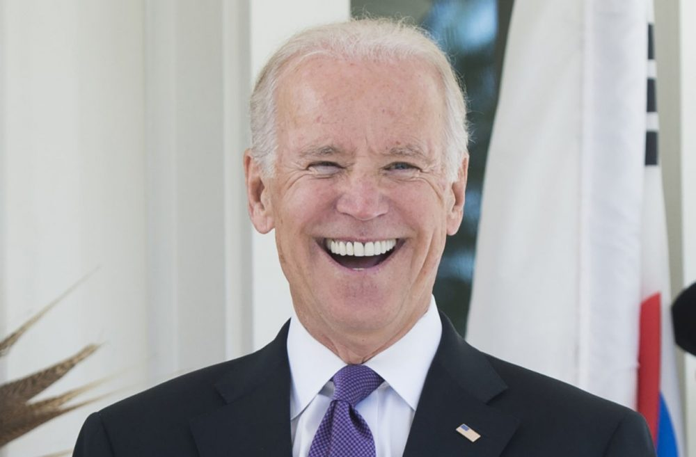 U.S. Vice President Joe Biden laughs during the arrival of the South Korean President for lunch at the Naval Observatory in Washington, D.C., October 15, 2015. (Saul Loeb/AFP/Getty Images)