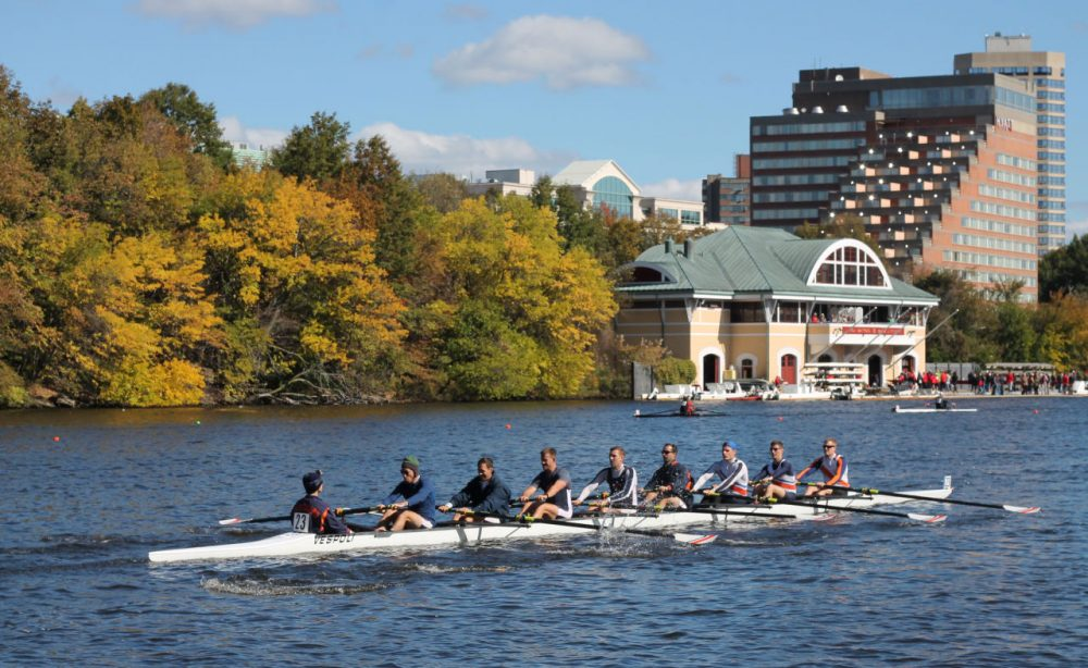 Rowers make their way past the Boston University Boathouse during the Head of the Charles competition on Saturday, Oct. 17, 2015. (Amy Gorel/WBUR)