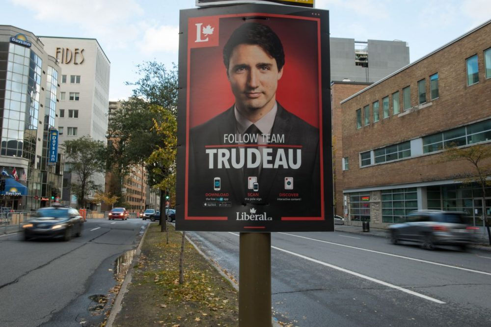 A poster for Canadian Liberal Party leader Justin Trudeau is seen on a street in Montreal on October 17, 2015. Canadians go to the polls on October 19 with the option of choosing to 'stay the course' with the Conservatives or plump for change touted by the Liberals and New Democrats, in legislative elections too close to call. (Nicholas Kamm/AFP/Getty Images)