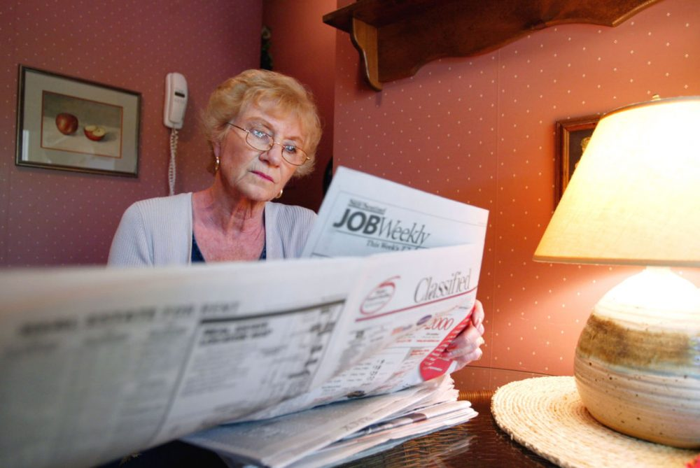 Anita Dante, in her late 60s, searches for a job in a local newspaper's classified section at her home July 26, 2002 in Margate, Florida. After working for most of her life, Dante had planned on retiring, but her plans have changed. A financial adviser explained that she should be more aggressive in her investments approximately 2 1/2 years ago. Dante has since lost most of her retirement nest egg and must now get a job to continue to support herself. Like Anita Dante, many people around the U.S., who are reaching retirement age, are having to rethink their strategy with investments plummeting and 401 (k) saving plans shrinking. (Joe Raedle/Getty Images)