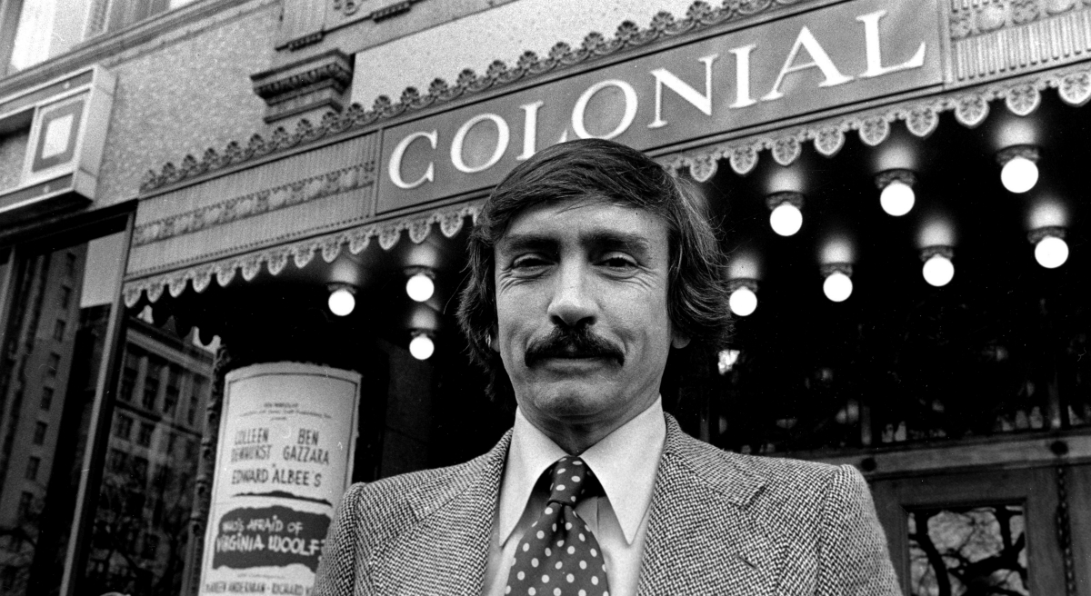 """Plans to transform the historic Boston landmark into a part-time cafeteria are meeting sharp criticism. In this photo, """"Who's Afraid of Virginia Woolf?"""" playwright Edward Albee poses in front of the Colonial Theatre on March 9, 1976 . (AP)"""