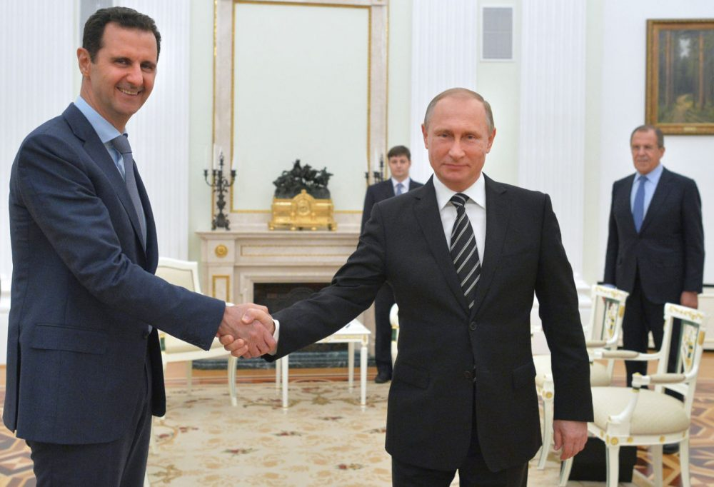 "Russian President Vladimir Putin (right) shakes hands with his Syrian counterpart Bashar Assad (left) during a meeting at the Kremlin in Moscow on October 20, 2015. Assad, on his first foreign visit since Syria's war broke out, told his main backer and counterpart Putin in Moscow that Russia's campaign in Syria has helped contain ""terrorism."" (Alexey Druzhnin/AFP/Getty Images)"