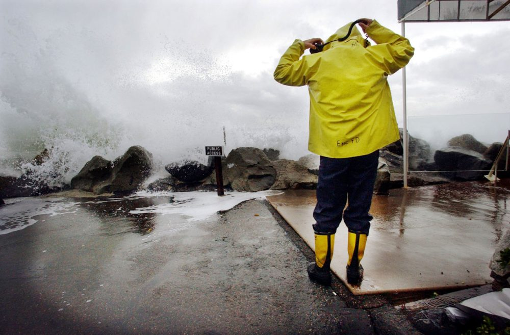 Heavy rains and large surf pounded the West Coast as a product of El Nino in December 2002. Another El Nino is supposed to hit the area, leaving many wondering how to store the rain for drier times. Here, Encinitas fireman Mike Kemp adjusts his hood as a wave crashes over a sea wall December 20, 2002 in Cardiff-by-the-Sea, California as firemen worked to help clear flooded buildings. (Sandy Huffaker/Getty Images)