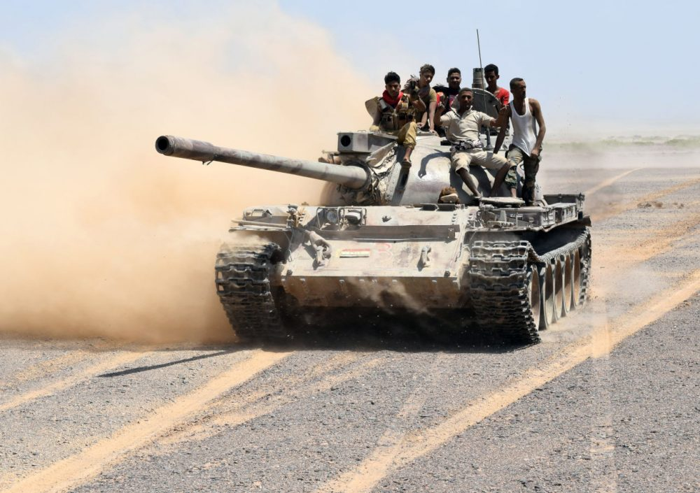 Fighters loyal to Yemeni President Abdrabbuh Mansour Hadi drive a tank in the area of the strategic Bab al-Mandab Strait, in the southern Yemeni province of Taez, on October 1, 2015. Pro-Hadi forces backed by the Saudi-led coalition, seized Bab al-Mandab and Dhubab in Taez province near the strait at the entrance to the Red Sea, from Shiite Huthi rebels, loyalist military official Abedrabbo al-Mihwali told AFP. (Saleh al-Obeidi/AFP/Getty Images)