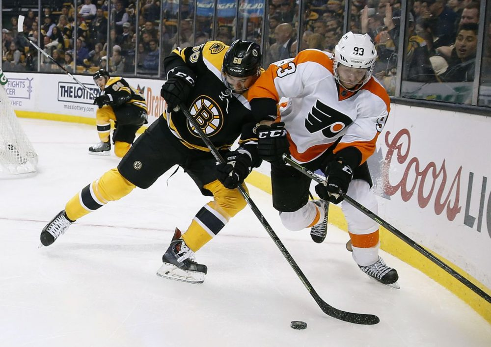 Boston Bruins' Tommy Cross (56) and Philadelphia Flyers' Jakub Voracek (93) battle for the puck during the third period of the game at TD Garden yesterday. (Michael Dwyer/AP)