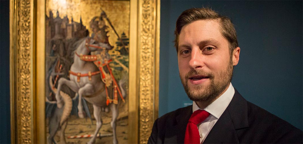 "Curator Nat Silver stands in front of Carlo Crivelli's iconic ""Saint George Slaying the Dragon,"" at the Isabella Stewart Gardner Museum. (Jesse Costa/WBUR)"