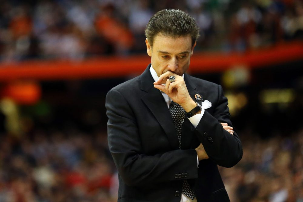 The Louisville Cardinals and head coach Rick Pitino are under scrutiny after anonymous players say their recruitment involved going to parties where their assistant head coach provided strippers. (Maddie Meyer/Getty Images)