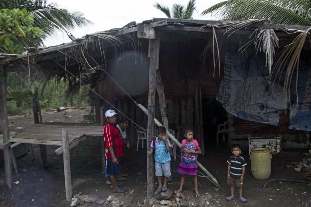 """Residents of Boca de Pascuales, Colima State, Mexico, prepare to be evacuated before the arrival of hurricane Patricia. Fast-moving Patricia grew into an """"extremely dangerous"""" major hurricane off Mexico's Pacific coast on Thursday, forecasters said, warning of possible landslides and flash flooding. (Hector Guerrero/AFP/Getty Images)"""