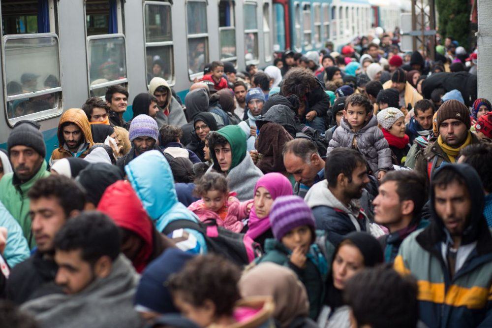 Refugees and migrants walk out of the train station in Sentilj, Slovenia, on their way to cross the Slovenian-Austrian border on October 23, 2015. Some thousands of migrants arrived to the border in Spielfeld in their attempt to get asylum in Austria or Germany. (Vladimir Simicek/AFP/Getty Images)