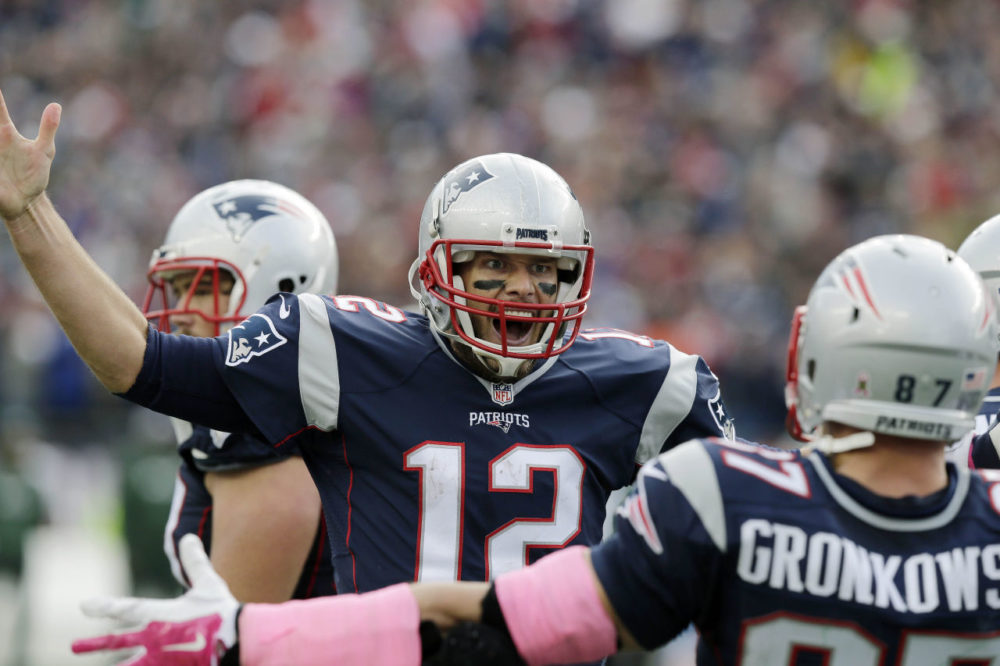 New England Patriots quarterback Tom Brady (12) celebrates his touchdown pass to tight end Rob Gronkowski (87) during the second half of an NFL football game, Sunday, in Foxborough, Mass. (Charles Krupa/AP)