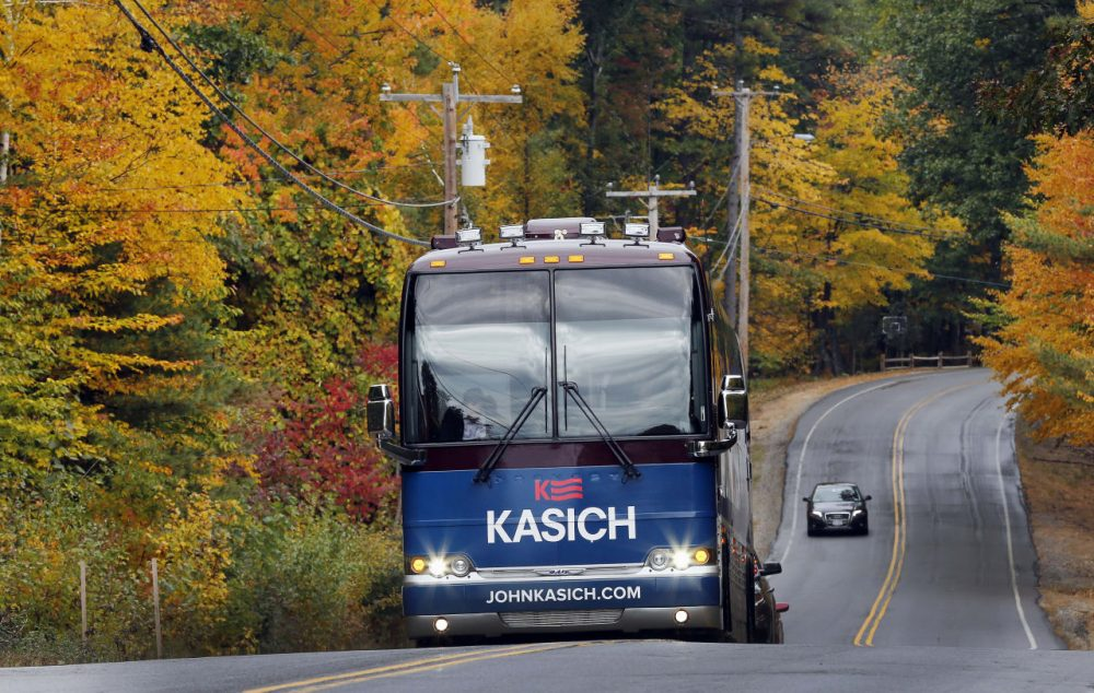 Republican presidential candidate, Ohio Gov. John Kasich rides through the fall colors in his bus as he campaigns in the nation's earliest presidential primary state. (Jim Cole/AP)