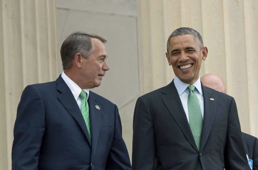 President Barack Obama walks with Speaker of the House John Boehner as they depart the annual Friend's of Ireland luncheon on Capitol Hill in Washington, DC, March 17, 2015. With just seven days remaining until the debt ceiling deadline, Republican congressional leaders and President Obama have reached a tentative budget deal. (Jim Watson/AFP/Getty Images)