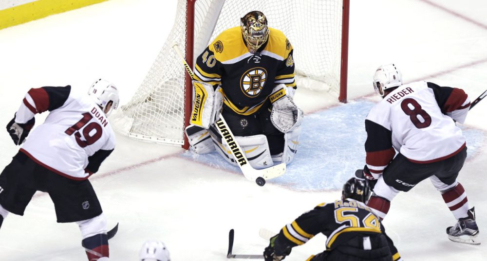 Boston Bruins goalie Tuukka Rask (40) makes a save as Arizona Coyotes right wing Shane Doan (19) and center Tobias Rieder (8) look for the rebound during the third period of the game at the TD Garden yesterday. (Charles Krupa/AP)